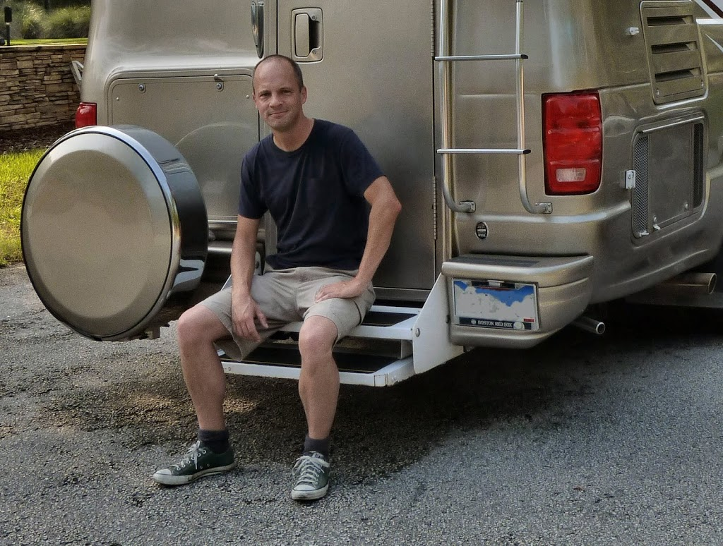 Man sitting on RV bumper