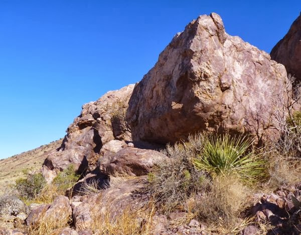 Huge boulder on hillside