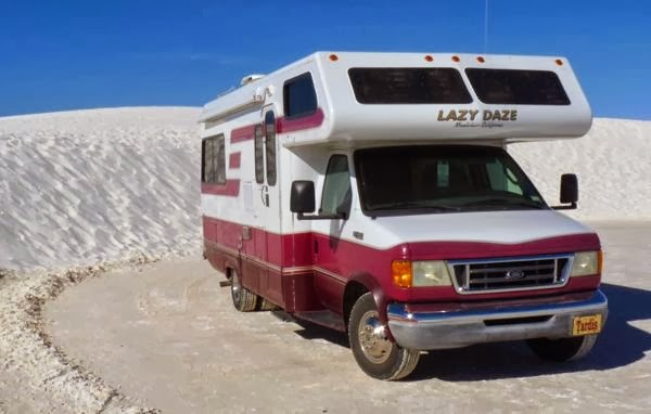 Motorhome in front of sand dunes