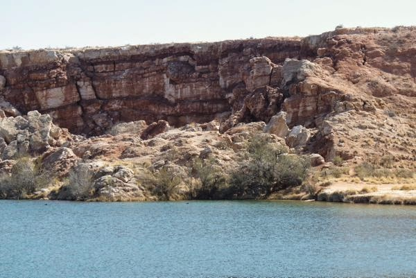 Lake with cliffs on far edge