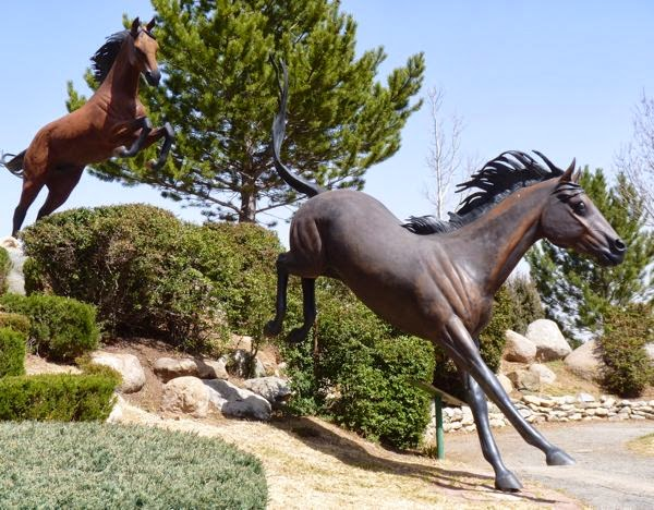 Horse sculpture running