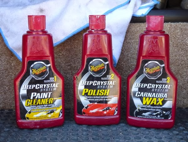 Three bottles of cleaner, polish and wax
