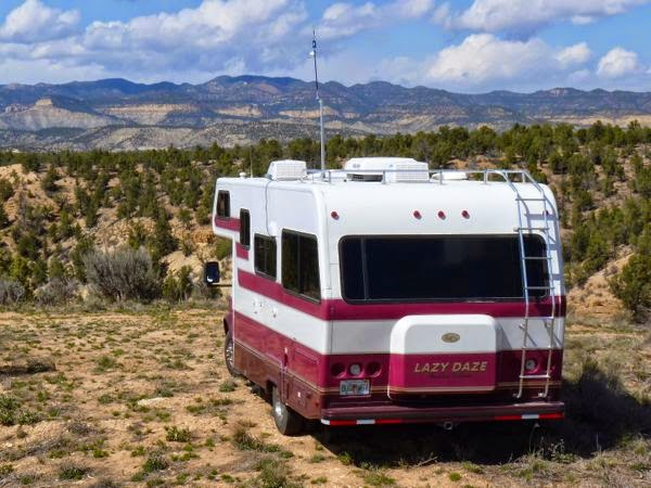 RV overlooking mountains with antenna