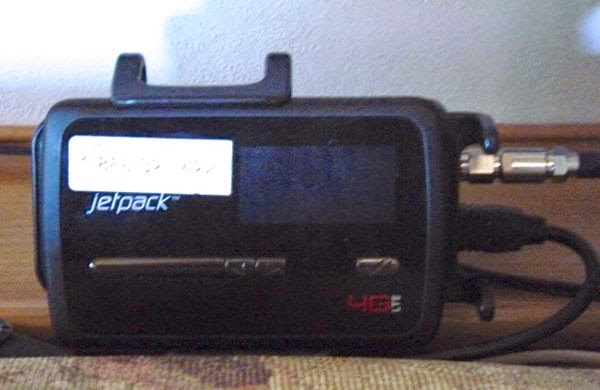 MiFi Jetpack held by booster