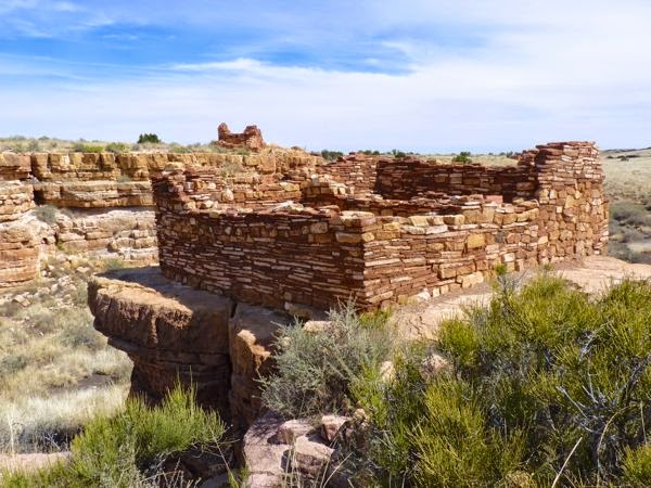 Stone structures on rim of canyon