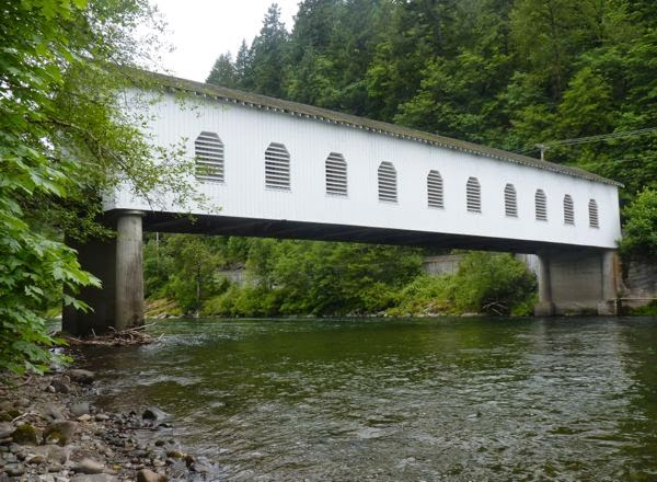 Covered bridge spanning river