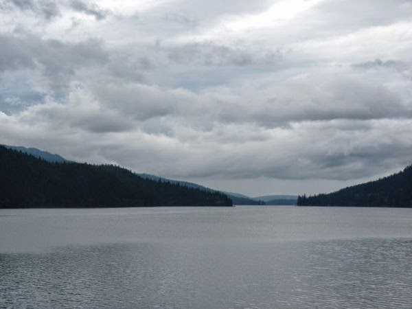 Lake, mountains, cloudy sky