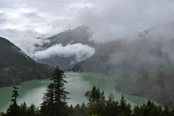 Lake with cloud shrouded mountains
