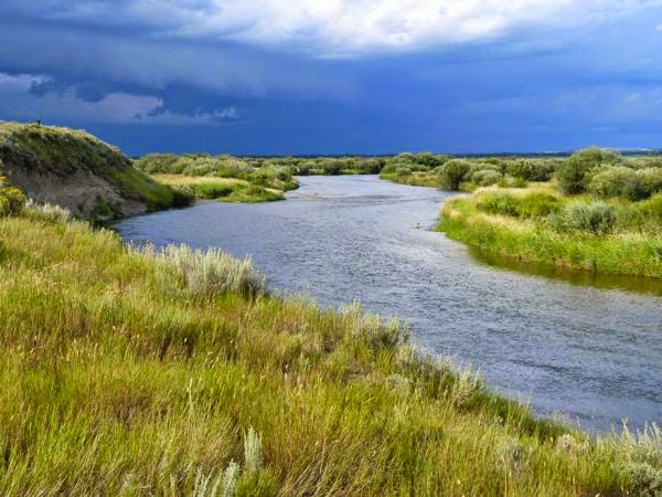 River on the prairie with cloudy sky