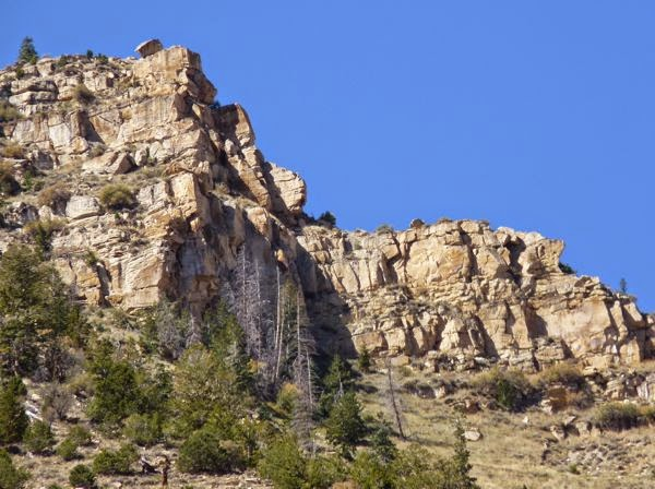Tall cliffs against blue sky