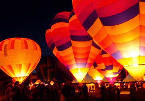 Balloons lit up at night
