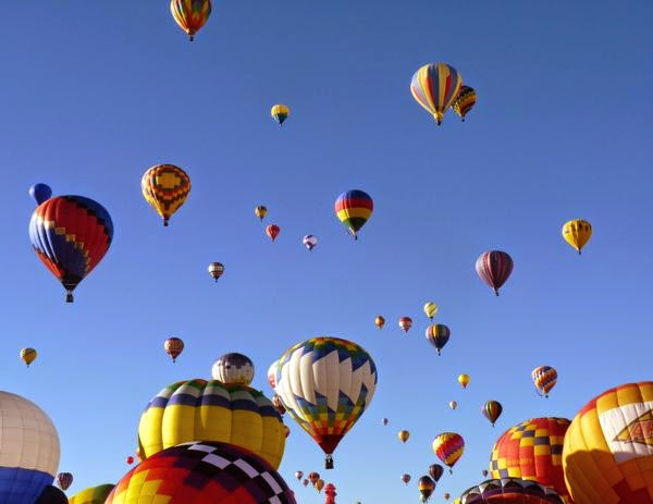 Lots of balloons against a blue sky