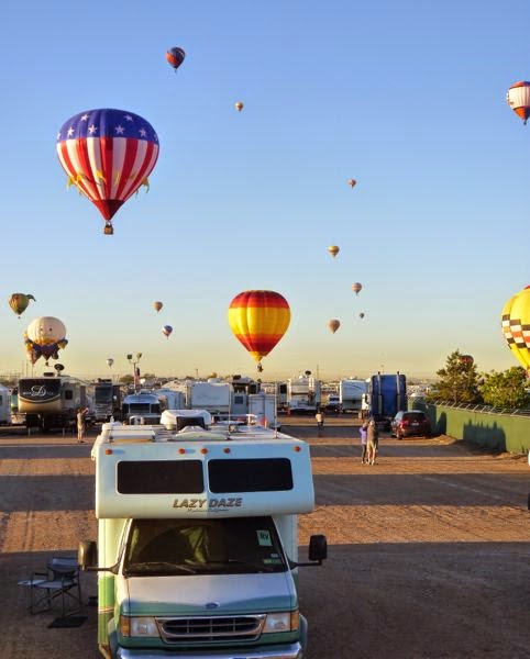 Many balloons coming down at RV campsite