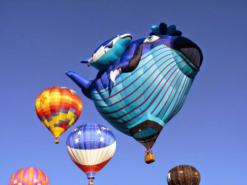 Whale shaped balloon agains sky