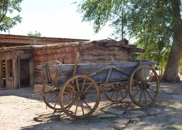 Old cabin and wagon