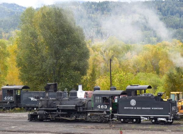 Train engines with steam rising