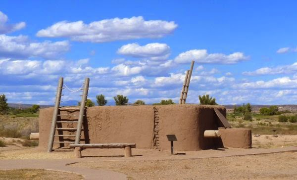 Adobe kiva agains cloudy sky