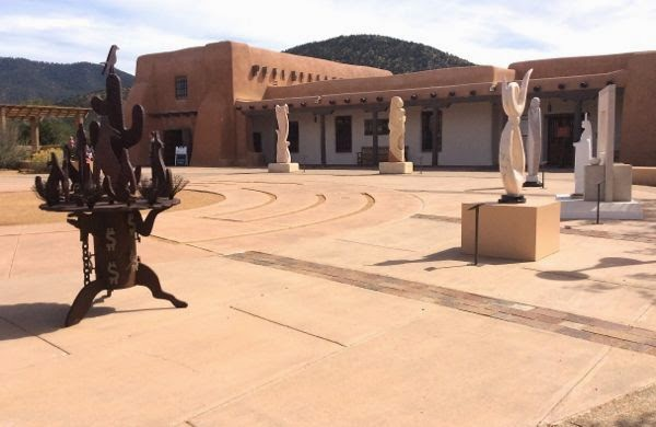 Sculpture patio with adobe building