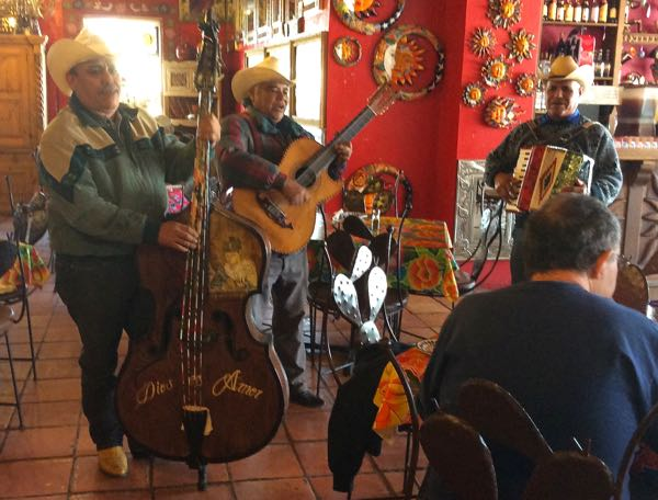 Mexican trio in restaurant