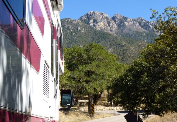 RV, trees, mountain