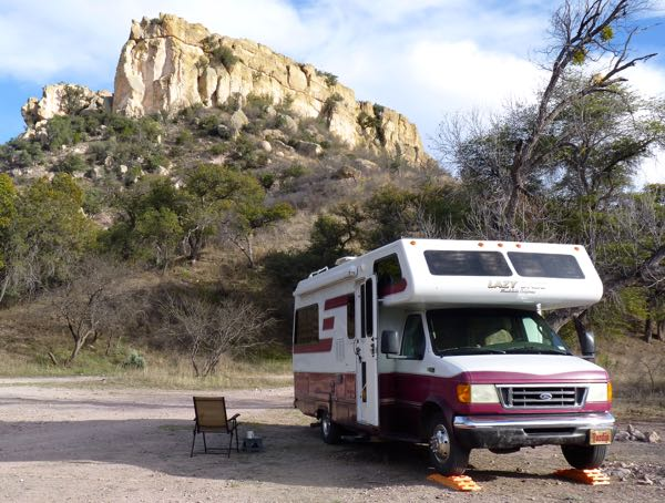 RV, tree, cliff
