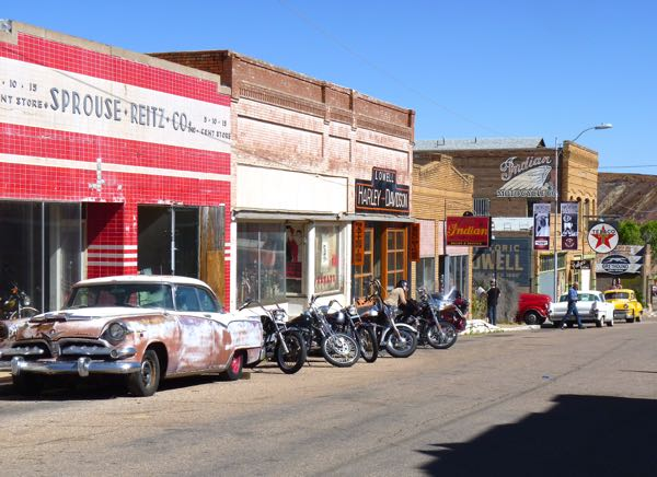Old cars, motorcycles  and store fronts