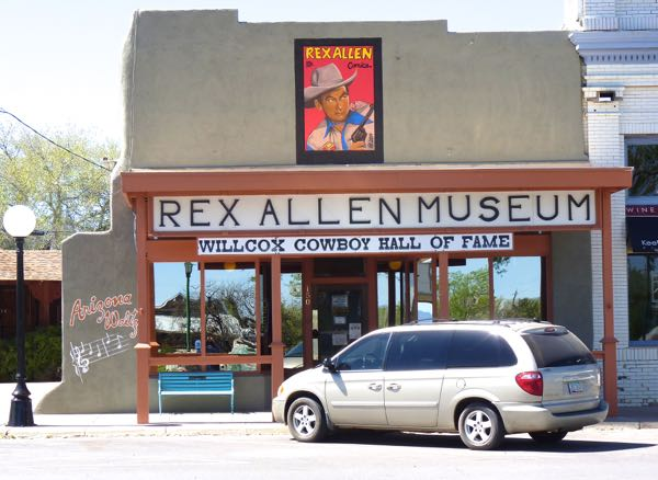 Storefront, museum, car