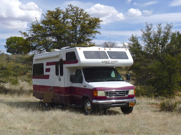 Motorhome, trees, grass field