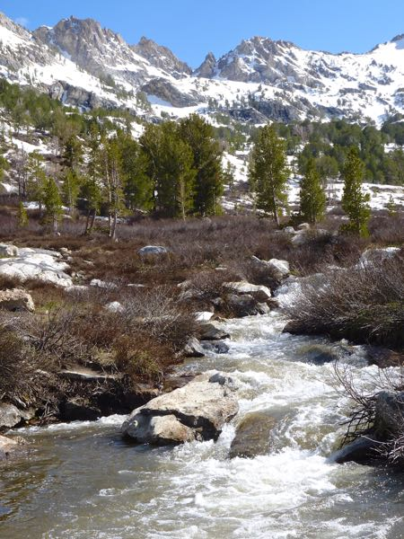 Snow capped mountains and creek