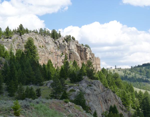 Cliff, trees, clouds
