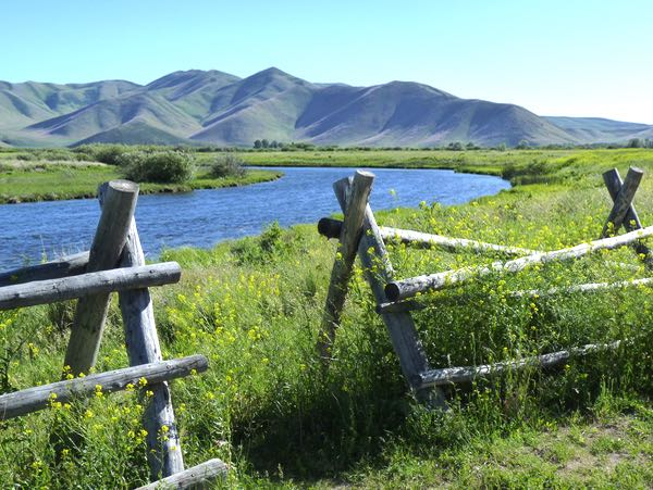 Creek, mountains, fence, field