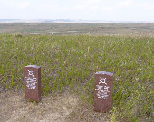 Grave markers, grass, hills