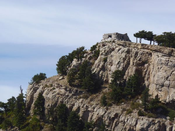 Cliff, cabin, trees