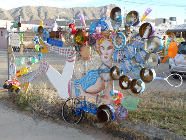 Mixed media collage on fence