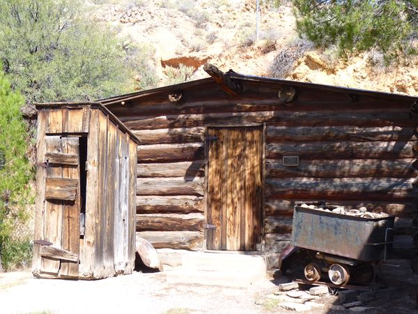 Cabin, outhouse, miner's cart