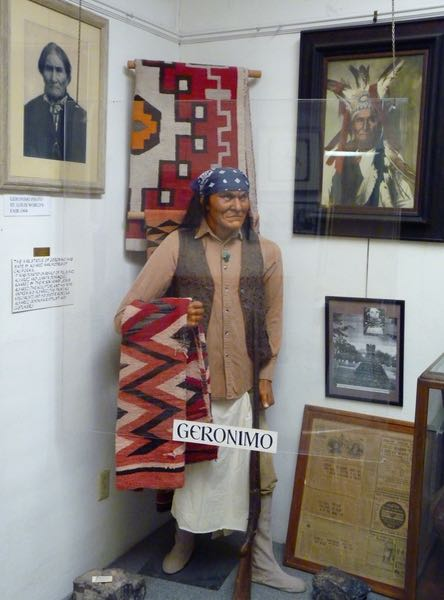 Statue, photos, native rugs